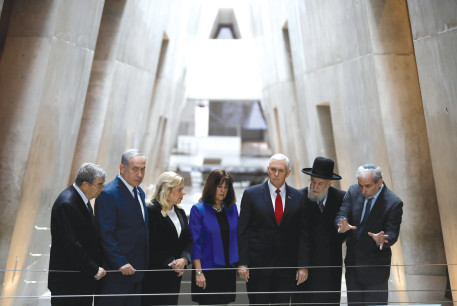 US Vice President Mike Pence and his wife, Karen (center), stand alongside Prime Minister Benjamin Netanyahu and his wife, Sara, at the Yad Vashem Holocaust History Museum in Jerusalem in 2018.