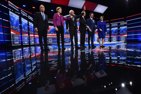 Candidates gather onstage for the ninth Democratic 2020 U.S. presidential debate at the Paris Theater in Las Vegas, Nevada, U.S.