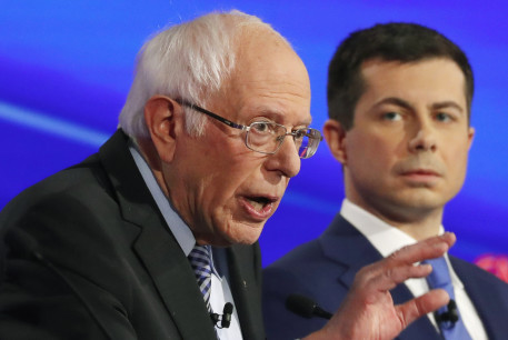 Democratic 2020 US presidential candidate Senator Bernie Sanders (I-VT) talks as former South Bend Mayor Pete Buttigieg looks on in the seventh Democratic 2020 presidential debate in Iowa, January 14, 2020.
