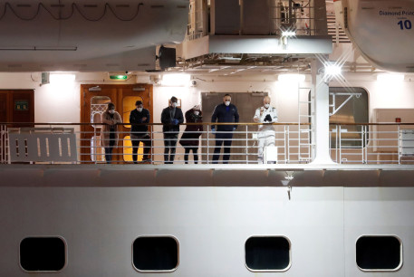 Passengers on the deck wave to another passengers, believed to be British citizens, as they leave the coronavirus-hit cruise ship Diamond Princess at the Daikoku Pier Cruise Terminal in Yokohama, south of Tokyo, Japan February 22, 2020