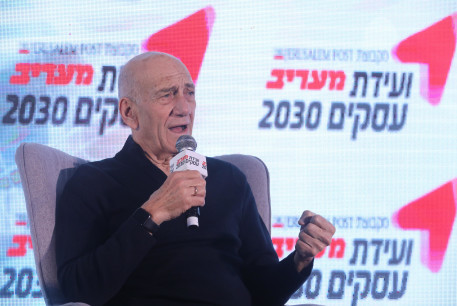 Foremer prime minister Ehud Olmert speaks at the Maariv Business Conference on February 26, 2020