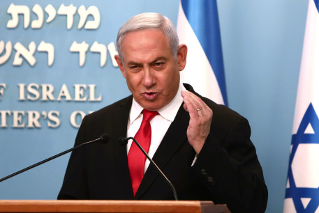 Israeli Prime Minister Benjamin Netanyahu gestures as he delivers a speech at his Jerusalem office, regarding the new measures that will be taken to fight the coronavirus, March 14, 2020