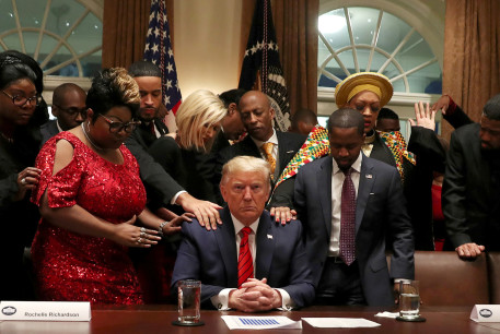 African-American supporters, including Terrence Williams, Angela Stanton and Diamond and Silk, pray with U.S. President Donald Trump in the Cabinet Room of the White House in Washington, US.