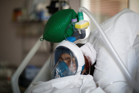 A patient suffering from coronavirus disease (COVID-19) wears a full-face Easybreath snorkelling mask given by sport chain Decathlon and turned into a ventilator for coronavirus treatment