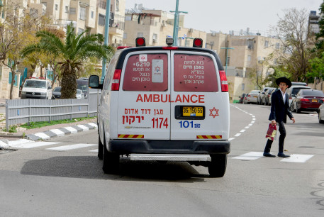 An ambulance driving in the central Israeli city of Elad, April 5, 2020