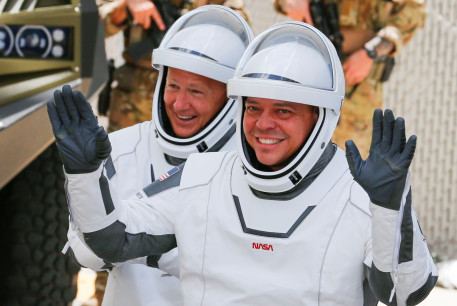 NASA astronauts Douglas Hurley and Robert Behnken head to launch pad 39 to board a SpaceX Falcon 9 rocket for a second launch attempt on NASA?s SpaceX Demo-2 mission to the International Space Station from NASA?s Kennedy Space Center in Cape Canaveral, Florida, US May 30, 2020