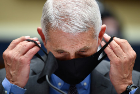 Director of the National Institute for Allergy and Infectious Diseases Dr. Anthony Fauci takes off his face mask prior testifying before the House Committee on Energy and Commerce on the Trump Administration's Response to the COVID-19 Pandemic, on Capitol Hill in Washington, DC, U.S. June 23, 2020