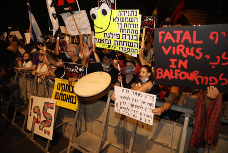 Protesters demonstrate outside the prime minister's residence in Balfour.