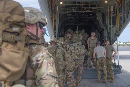 US Army soldiers, assigned to the East Africa Response Force (EARF), 101st Airborne Division on a mission to bolster the security of Manda Bay Airfield, Kenya after an attack by Somalia's al Shabaab militants that killed three Americans, board a transport plane in Camp Lemonnier, Djibouti January 5,