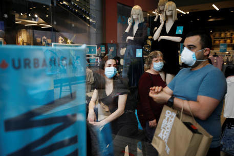 Shoppers wear face masks and walk around a fashion shopping center in Ashdod, as restrictions over the coronavirus disease (COVID-19) ease around Israel, May 5, 2020