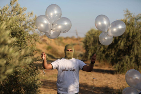 Balloon units prepare incendiary and explosive balloons to launch towards Israel, August 12, 2020