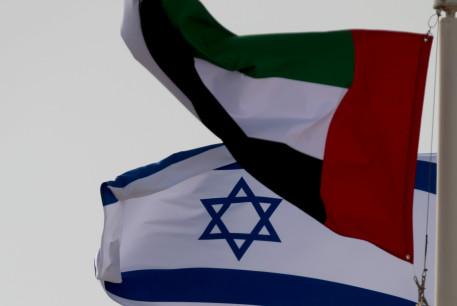 A United Arab Emirates (UAE) flag waves alongside an Israeli flag