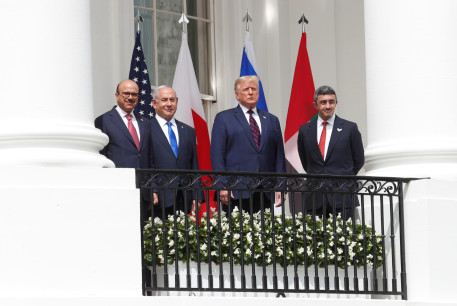 Abdullatif Al Zayani, Benjamin Netanyahu, Donald Trump, and Abdullah bin Zayed sign the Abraham Accords