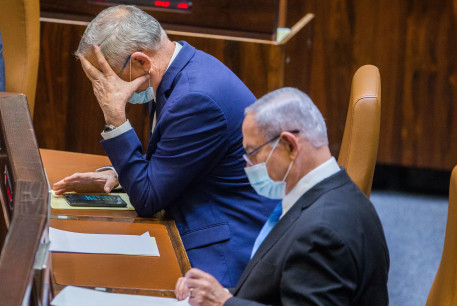 Alternate Prime Minister and Minister of Defense Benny Gantz and Israeli Prime Minister Benjamin Netanyahu seen during a vote at the Knesset, the Israeli parliament in Jerusalem on August 24, 2020.