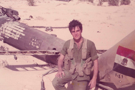The author next to a downed Egyptian helicopter during the Yom Kippur War.