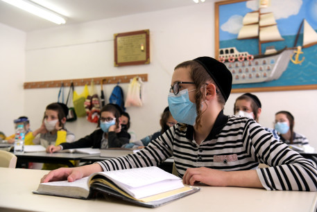 Ultra-Orthodox children wearing face masks at their school in the city of Rehovot, May 24, 2020