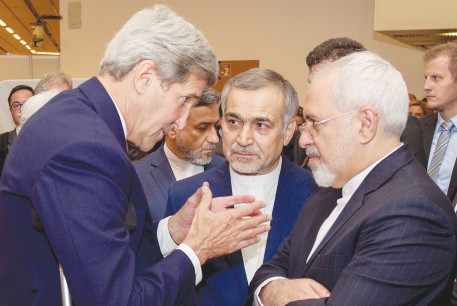 FORMER US secretary of state John Kerry speaks to Iranian Foreign Minister Javad Zarif as Hossein Fereydoun, the brother of Iranian President Hassan Rouhani, looks on in Vienna, Austria, July 14, 2015.
