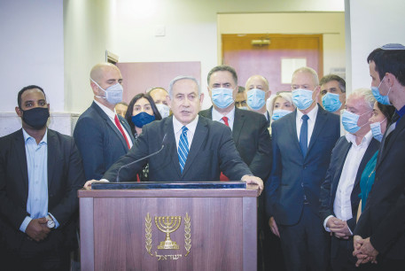 PRIME MINISTER Benjamin Netanyahu gives a press statement ahead of the start of his trial at the District Court in Jerusalem in May.