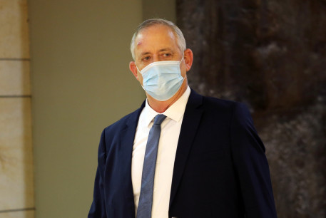 sraeli Defence Minister Benny Gantz wears a protective face mask as he arrives to attend a vote on the approval of the normalisation deal with the United Arab Emirates at the Knesset, Israel's parliament, in Jerusalem October 15, 2020.