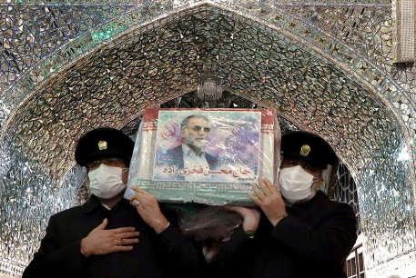 Servants of the holy shrine of Imam Reza carry the coffin of Iranian nuclear scientist Mohsen Fakhrizadeh, in Mashhad, Iran November 29, 2020.