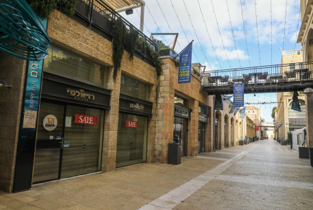 Stores in Jerusalem's Mamilla mall are seen closed amid the ongoing coronavirus lockdown, on January 14, 2021.