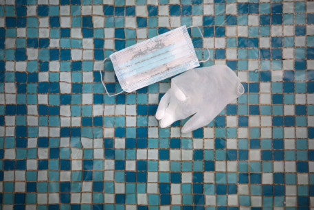 A glove and face mask float in a mosaic-covered water fountain amid Israel's third national lockdown to fight the coronavirus disease (COVID-19), in Ashkelon, Israel January 20, 2021.