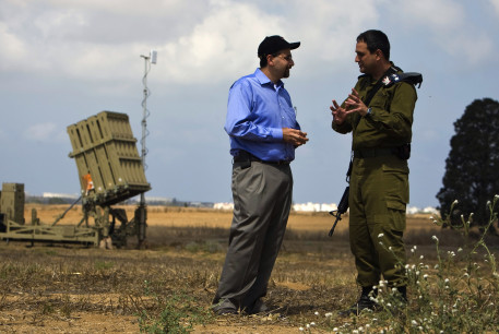 Dan Shapiro listens to an IDF officer as they stand next to an Iron Dome launcher in a field near the southern city of Ashkelon.