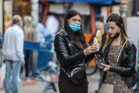 Israelis in Jerusalem are seen with ice cream ahead of an expected snowfall, on February 16, 2021.