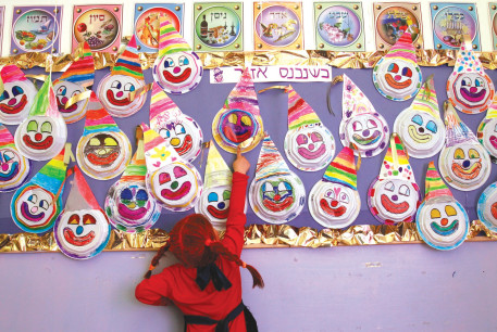 Making merry at a school Purim party in years past