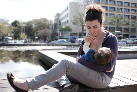 Israeli women take part at a Mass Breastfeeding as they gathered at Rabin Square in Tel Aviv on March 18, 2016, the idea  was to promote women's right to breastfeeding their babies in public, March 18, 2016. Photo by Tomer Neuberg/Flash90