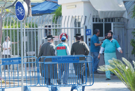 NEXT OF KIN of the victims of last week's tragedy at Mount Meron arrive at the Abu Kabir Forensic Institute in Tel Aviv to identify the bodies of their loved ones.