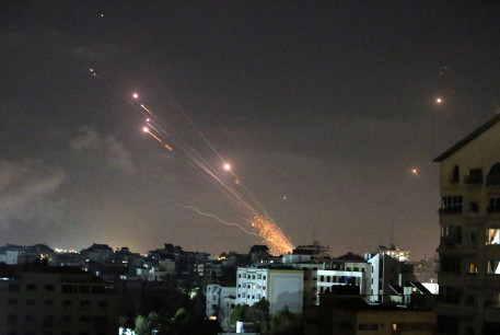 Rockets are launched by Palestinian militants into Israel, in Gaza May 12, 2021.
