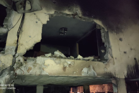 Damage caused to a building in Petah Tikva by Hamas rocket fire, May 13, 2021