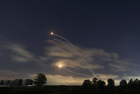 A long exposure picture shows iron dome anti-missile system fires interception missile as rockets fired from the Gaza Strip to Israel, as it seen from southern Israel, May 13, 2021.
