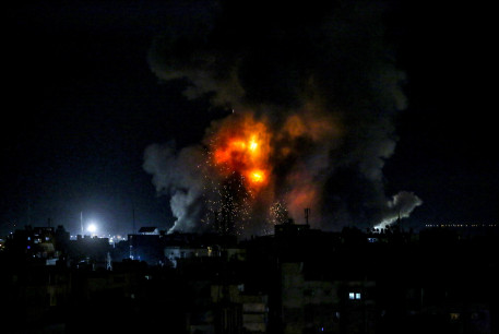 Flames and smoke billowing after an Israeli air strike on the city of Khan Yunis, in the southern Gaza Strip, on May 16, 2021.
