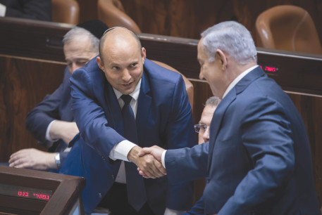 PRIME MINISTER Benjamin Netanyahu and then-education minister Naftali Bennett in the Knesset in 2017.