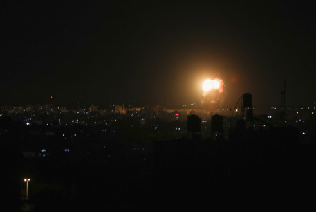 Smoke and flames are seen after an Israeli air strike in the northern Gaza Strip