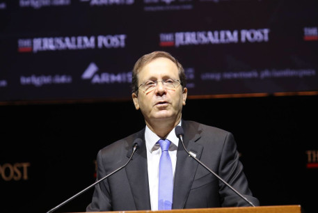 Israel's President Isaac Herzog is seen addressing the Jerusalem Post annual conference at the Museum of Tolerance in Jerusalem, on October 12, 2021.