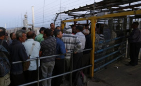 Palestinians wait to cross into Israel at Jalama crossing near Jenin