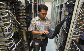 A computer engineer checks equipment at an internet service provider in Tehran February 15, 2011
