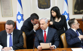 Prime Minister Benjamin Netanyahu whispering in a cabinet meeting on July 23, 2018