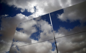 Heliostat mirrors reflect the sky in a field at the construction site of a 240 meter (787 feet) solar-power tower in Israel's southern Negev Desert, February 8, 2016. The world's tallest solar-power tower is being built off a highway in the Negev Desert in southern Israel, its backers hoping the tec