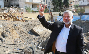 Hamas chief Ismail Haniyeh next to his destroyed office (REUTERS/Handout)