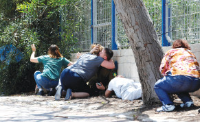 RESIDENTS OF the South take cover last week after hearing sirens warning of incoming rockets from Gaza.