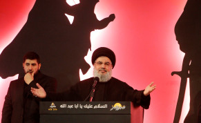 Hezbollah leader Sayyed Hassan Nasrallah addresses his supporters during a public appearance at a religious procession