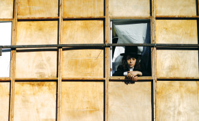 A BOY looks out through a window of a sukkah in Ashdod