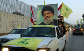 Supporters of Lebanon's Hezbollah leader Sayyed Hassan Nasrallah ride in a vehicle decorated with Hezbollah and Lebanese flags and a picture of him, as part of a convoy in the southern village of Kfar Kila, Lebanon October 25, 2019