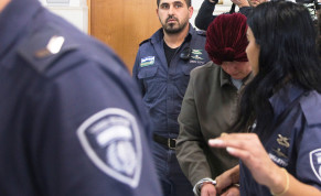 Malka Leifer, a former Australian school principal who is wanted in Australia on suspicion of sexually abusing students, walks in the corridor of the Jerusalem District Court accompanied by Israeli Prison Service guards, in Jerusalem