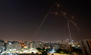 Iron Dome anti-missile system fires interception missiles as rockets are launched from Gaza towards Israel