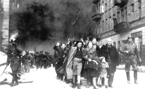 Captured Jews pulled out of Warsaw Ghetto bunkers are led by German Waffen SS soldiers to 'Umschlagplatz,' the assembly point for deportation.
